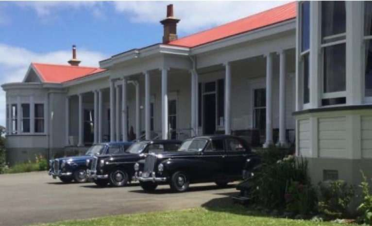 Cars in front of the homestead