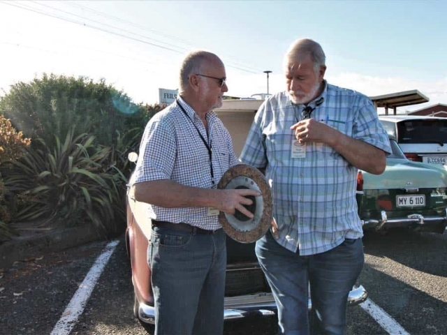 Derek Brehaut and Hugh Mackenzie discussing cork clutch plate from a 25HP super 6