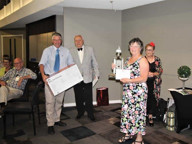 Gordon and Beryl Duthie receiving prize from Winton Cleal assisted by Ruth again